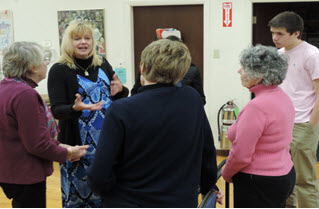 KeliKhatib, in blue dress, and Alexander on the far right, answer questions about Islam following a breakfast presentation at Nahant Village Church.